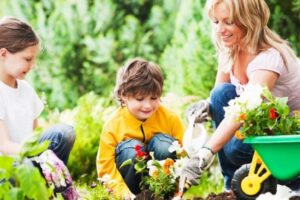 Children gardening with parents